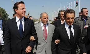 David Cameron and Nicolas Sarkozy flanking Libyan leader Mustafa Abdel Jalil. Copyright © 2011 Stefan Rousseau/PA