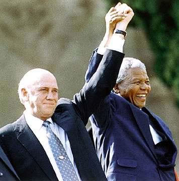 Mandela at his inaugutation,with outgoing South African president F W De Klerk, 10 May 1994