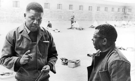 Nelson Mandela in the prison courtyard on Robben Island, with fellow African National Congress leader, Walter Sisulu